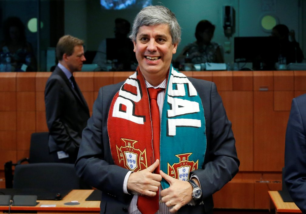 Portugal's Finance Minister Centeno poses with a national scarf during an euro zone finance ministers meeting in Brussels